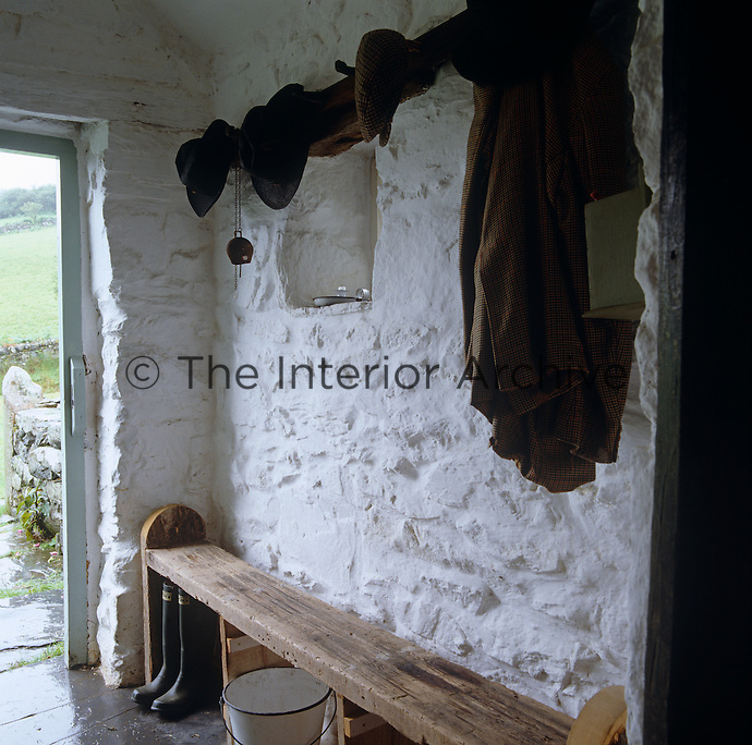 Like all walls in the house those of the entrance hall have been lime washed in the vernacular style