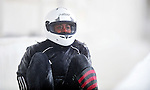 16 December 2010:  Shelly-Ann Brown of Canada watches her 2-man bobsled slide down the track without her after a spill in a training run prior to the Viessmann FIBT World Cup Championships in Lake Placid, New York, USA. Mandatory Credit: Ed Wolfstein Photo