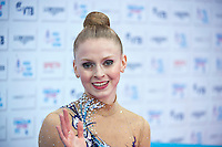 "September 09, 2015 - Stuttgart, Germany - JAZZY KERBER  of USA waves from ""kiss & cry"" during AA qualifications at 2015 World Championships."
