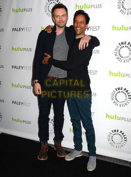 Joel McHale, Danny Pudi.The Paley Center For Media's PaleyFest 2013 Honoring 'Community' at Saban Theatre, Los Angeles, California, USA.  .March 5th, 2013.full length black suit grey gray top arms around hug embrace trousers blue .CAP/ADM/BT.©Birdie Thompson/AdMedia/Capital Pictures.