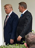 United States President Donald J. Trump, left, and President Klaus Iohannis of Romania, right, walk on the Colonnade of the White House in Washington, DC on Tuesday, August 20, 2019.<br /> Credit: Ron Sachs / CNP