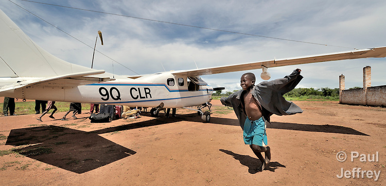 Children in the village of Luena, in the Democratic Republic of the Congo, are inspired to attempt flight by the presence of a plane from the Wings of the Morning aviation ministry of The United Methodist Church.