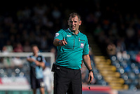 Referee Tim Robinson during the Sky Bet League 2 match between Wycombe Wanderers and Plymouth Argyle at Adams Park, High Wycombe, England on 12 September 2015. Photo by Andy Rowland.
