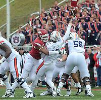 NWA Democrat-Gazette/MICHAEL WOODS • @NWAMICHAELW<br /> University of Arkansas defender Deatrich Wise Jr hits Auburn quarterback Sean White just as he throws the ball during Saturdays game October, 24, 2015 against Auburn at Razorback Stadium in Fayetteville.