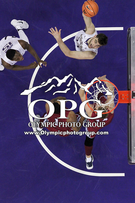 SEATTLE, WA - DECEMBER 17: Washington's (33) Sam Timmons (C) does a hook shot to the basket during first half action.  Washington won 80-77 over Loyola Marymount at Alaska Airlines Arena in Seattle, WA.