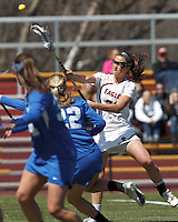 Boston College midfielder Cali Ceglarski (23) takes a shot.Boston College (white) defeated Duke University (blue), 10-9, on the Newton Campus Lacrosse Field at Boston College, on April 6, 2013.