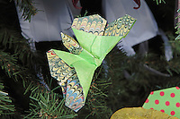 OrigamiUSA holiday tree at the American Museum of Natural History 2014. Detail of models: origami butterfly deigned and folded by John Szinger.