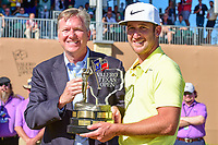Kevin Chappell (USA) is presented the Valero Texas Open trophy by Mr. Gary Simmons of Valero Corporation  following round 4 of the Valero Texas Open, AT&amp;T Oaks Course, TPC San Antonio, San Antonio, Texas, USA. 4/23/2017.<br /> Picture: Golffile | Ken Murray<br /> <br /> <br /> All photo usage must carry mandatory copyright credit (&copy; Golffile | Ken Murray)