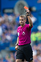 Referee Craig Pawson shows a red card to Chelsea's Cesc Fabregas (not pictured)<br /> <br /> Photographer Craig Mercer/CameraSport<br /> <br /> The Premier League - Chelsea v Burnley - Saturday August 12th 2017 - Stamford Bridge - London<br /> <br /> World Copyright &copy; 2017 CameraSport. All rights reserved. 43 Linden Ave. Countesthorpe. Leicester. England. LE8 5PG - Tel: +44 (0) 116 277 4147 - admin@camerasport.com - www.camerasport.com
