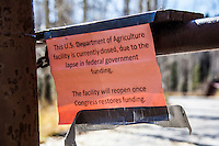 "A sign taped to the closed barrier to Sunrise Campground near Bear Lake in northeastern Utah reads, ""This U.S. Department of Agriculture facility is curently closed, due to the lapse in federal government funding.  The facility will reopen once Congress restores funding.""  However, funding was restored after the park's usual winter closing date."