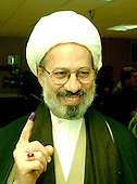McLean, VA - December 13, 2005 -- Imam Fadhel Al Sahlani, who emigrated to Jamaica, Queens, New York from Basra, Iraq, shows off his purple finger that shows he voted in the Iraqi election in McLean, Virginia on December 13, 2005.  Imam Al Sahlani is affiliated with the Al Khoei Benevolent Foundation in New York, New York..Credit: Ron Sachs / CNP.(RESTRICTION: NO New York or New Jersey Newspapers or newspapers within a 75 mile radius of New York City)