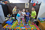 Iraqi children bounce on a bed in the basement of Sacred Heart Catholic church in Amman, Jordan, where 60 Iraqi Christian refugees are living. The Lutheran World Federation, a member of the ACT Alliance, has helped the church feed the refugees and remodel the basement into partitioned areas to provide some privacy for the ten refugee families.<br /> <br /> Parental consent obtained.
