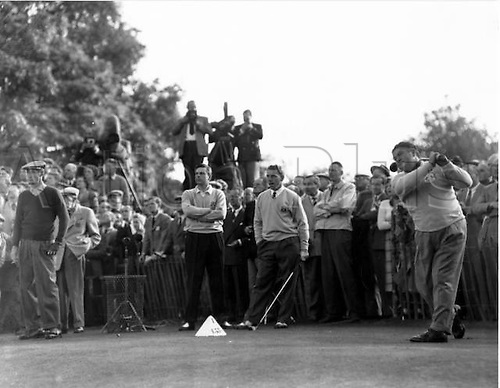 02.10.1953 Wentworth, England. Sam Snead, the America golfer drives off from the 1st tee in a foursomes match during the two day Ryder Cup tournament at Wentworth. With his team captain Lloyd Mangrum, he was opposing Britain's Eric Brown, and John Panton. 2nd October 1953