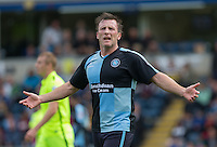 Garry Thompson of Wycombe Wanderers disputes a Linesman decision during the Sky Bet League 2 match between Wycombe Wanderers and Hartlepool United at Adams Park, High Wycombe, England on 5 September 2015. Photo by Andy Rowland.