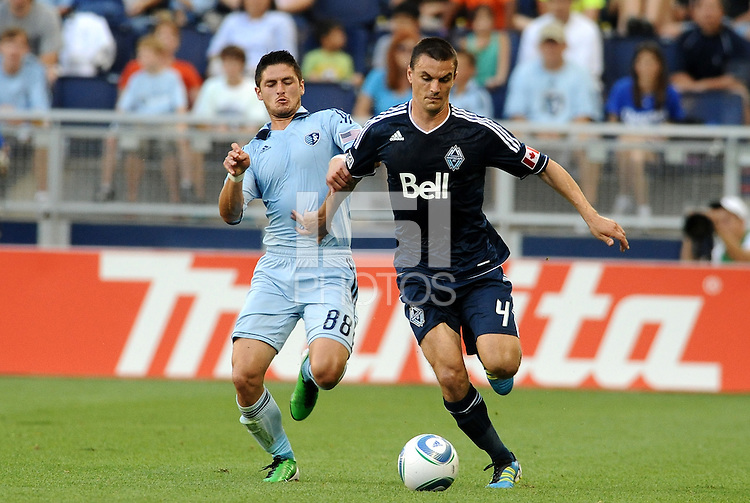 Vancouver Whitecaps defender Alain Rochat gets ahead of Milos Stojcev Sporting KC.                                                                               .. Sporting KC defeated Vancouver Whitecaps 2-1 at LIVESTRONG Sporting Park, Kansas City, Kanas.