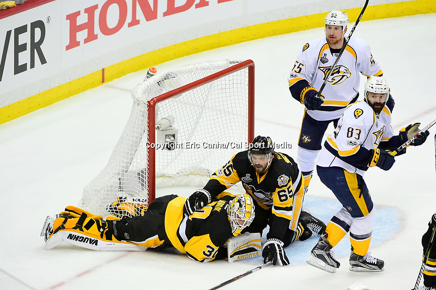May 29, 2017: Pittsburgh Penguins goalie Matt Murray (30) reacts in pain as defenseman Ron Hainsey (65) works to help him up  during game one of the National Hockey League Stanley Cup Finals between the Nashville Predators  and the Pittsburgh Penguins, held at PPG Paints Arena, in Pittsburgh, PA.   Eric Canha/CSM