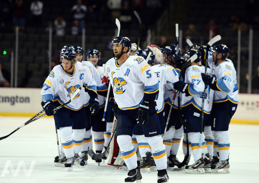 Oct 19, 2012; Toledo, OH, USA; Toledo Walleye players celebrate after left wing Terry Broadhurst (not pictured) scored the game winning goal in overtime to defeat the Cincinnati Cyclones at Huntington Center: Mandatory Credit: Andrew Weber
