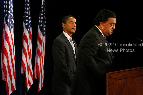 Chicago, IL - December 3, 2008 -- United States Secretary of Commerce designee and New Mexico Governor Bill Richardson (L) addresses reporters as United States President-elect Barack Obama stands by his side at news conference in Chicago on December 3, 2008. .Credit: Brian Kersey - Pool via CNP