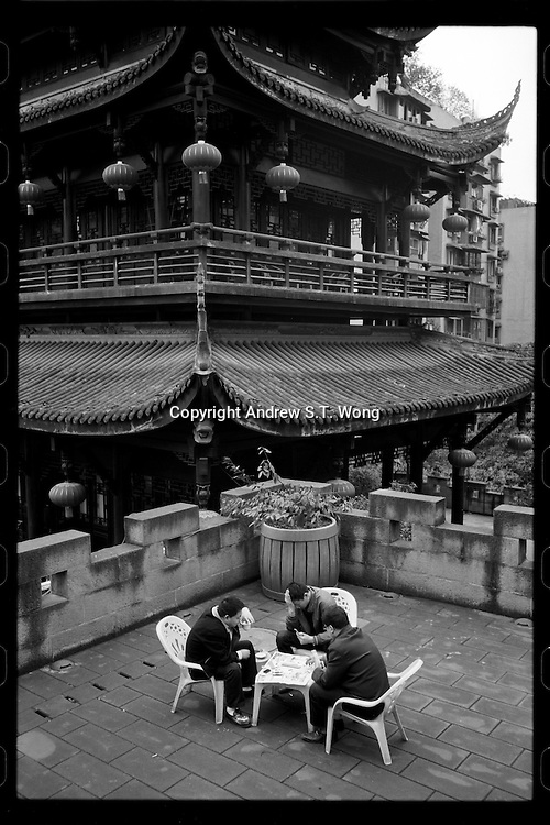 Residents enjoy tea on Tongyuanmen Gate in Chongqing, China's southwestern municipality, in April, 2011.