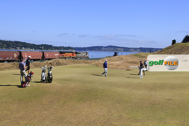 Hunter MAHAN (USA) on the 17th green as a freight train rolls by during Wednesday's Practice Day of the 2015 U.S. Open 115th National Championship held at Chambers Bay, Seattle, Washington, USA. 6/17/2015.<br /> Picture &copy; Golffile/Eoin Clarke