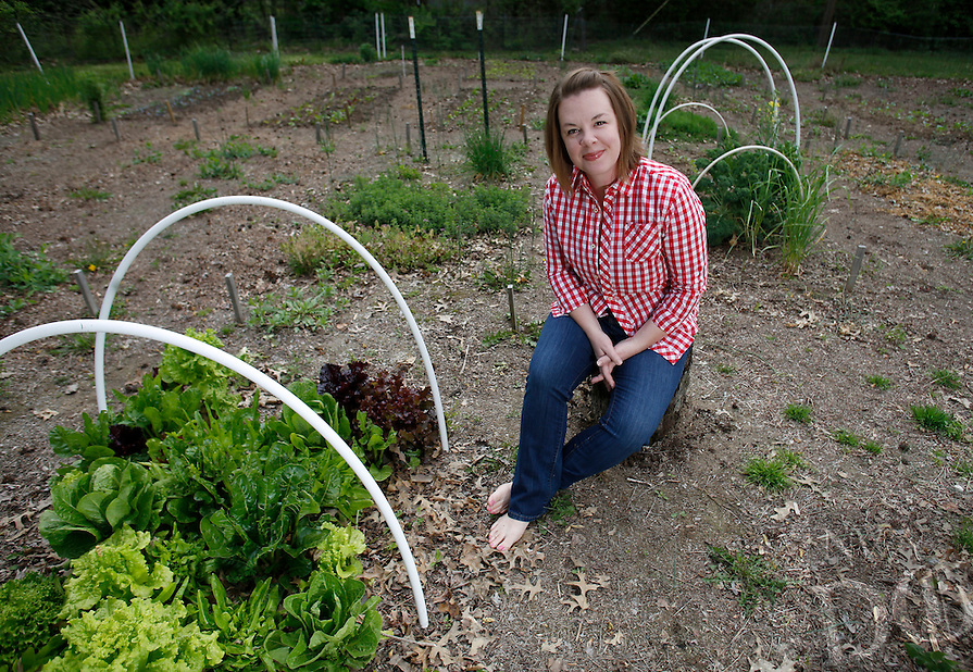 NWA Democrat-Gazette/DAVID GOTTSCHALK  Tiffany Selvey sits in her favorite personal space Thursday, April 14, 2016, the vegetable garden in the backyard of her home in Springdale.