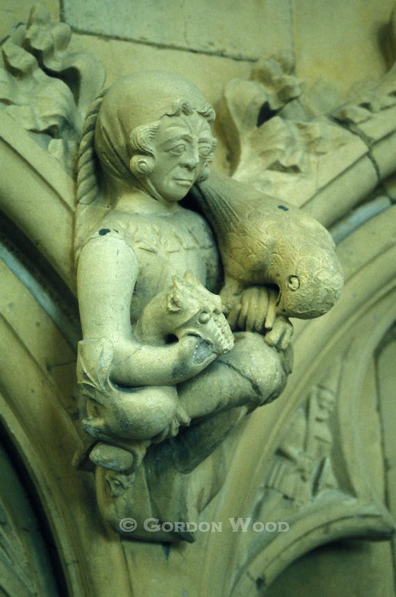 Gargoyle of Man with Bird and Dragon in Beverley Minster Church