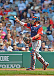 10 June 2012: Washington Nationals catcher Jesus Flores tosses some ball after a possible injury and being checked out by Head Athletic Trainer Lee Kuntz during action against the Boston Red Sox at Fenway Park in Boston, MA. The Nationals defeated the Red Sox 4-3 to sweep their 3-game interleague series. Mandatory Credit: Ed Wolfstein Photo
