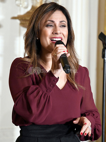 Worship leader and recording artist Julissa Arce Rivera performs prior to the arrival of United States President Donald J. Trump and first lady Melania Trump as they host a Hispanic Heritage Month event in the East Room of the White House in Washington, DC on Friday, October 6, 2017.  200 Hispanic business, community, and faith leaders, and guests from across the country have been invited to join in the celebration.<br /> Credit: Ron Sachs / CNP / MediaPunch