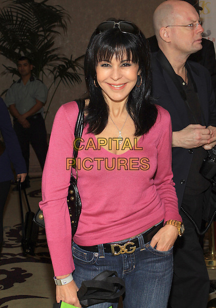 MARIA CONCHITA ALONSO  .Pre-Oscar Gifting Suite Of 100 Stars held at The Beverly Hills Hotel, Beverly Hills, California, USA..February 23rd, 2010.half length pink top hand in pocket .CAP/ADM/TC.©T. Conrad/AdMedia/Capital Pictures.
