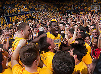 Jabari Bird of California and Kameron Rooks of California celebrate with the fans after winning the game against Arizona at Haas Pavilion in Berkeley, California on February 1st, 2014.  California Golden Bears defeated Arizona Wildcats, 60-58.