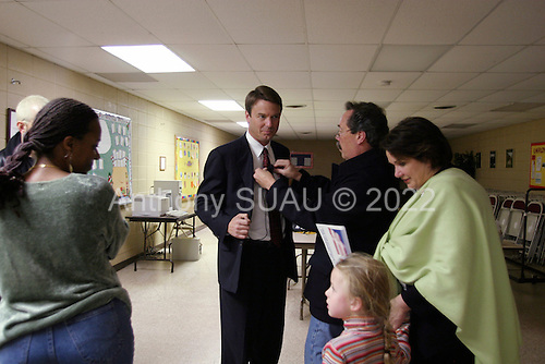 SEneca, South Carolina.USA.February 2, 2004..One day before the polls open in South Caroloina SEnator John Edwards has a rally in his birth town attened by his parents, wife and two childern. n a holding room he waits nerviously for his introduction....Seneca Institute Family Life Center