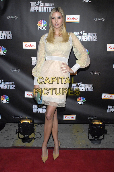 "IVANKA TRUMP.Viewing party for ""The Celebrity Apprentice"" at Tenjune sponsored by Kodak, New York, New York, USA..February 7th, 2008.full length white cream yellow lace sheer dress green clutch bag purse hand on hip .CAP/ADM/BL.©Bill Lyons/AdMedia/Capital Pictures. *** Local Caption ***"