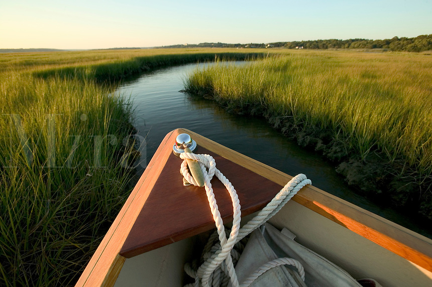 Detail of bow of boat, water and grasses nearing dusk. Westport River, Westport, Massachusetts.