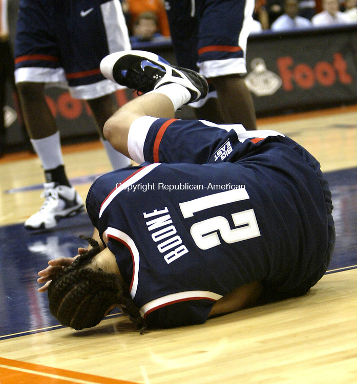 SYRACUSE, NY 16 JANUARY 2005 011605BZ04-     UConn  #21, Josh Boone lays on the ground after being struck in the head under the hoop <br /> <br /> during their game at the carrier Dome at Syracuse University Monday night. <br /> Jamison C. Bazinet Republican-American