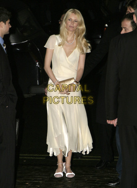 CLAUDIA SCHIFFER.The London Party, The Wallace Collection, Hertford House, Manchester Square, London, February 11th 2005..full length plae yellow cream dress gold clutch bag purse.Ref: AH.www.capitalpictures.com.sales@capitalpictures.com.©Capital Pictures.