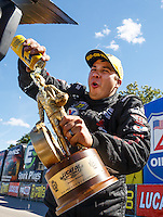 Aug 21, 2016; Brainerd, MN, USA; NHRA pro stock driver Drew Skillman celebrates after winning the Lucas Oil Nationals at Brainerd International Raceway. Mandatory Credit: Mark J. Rebilas-USA TODAY Sports