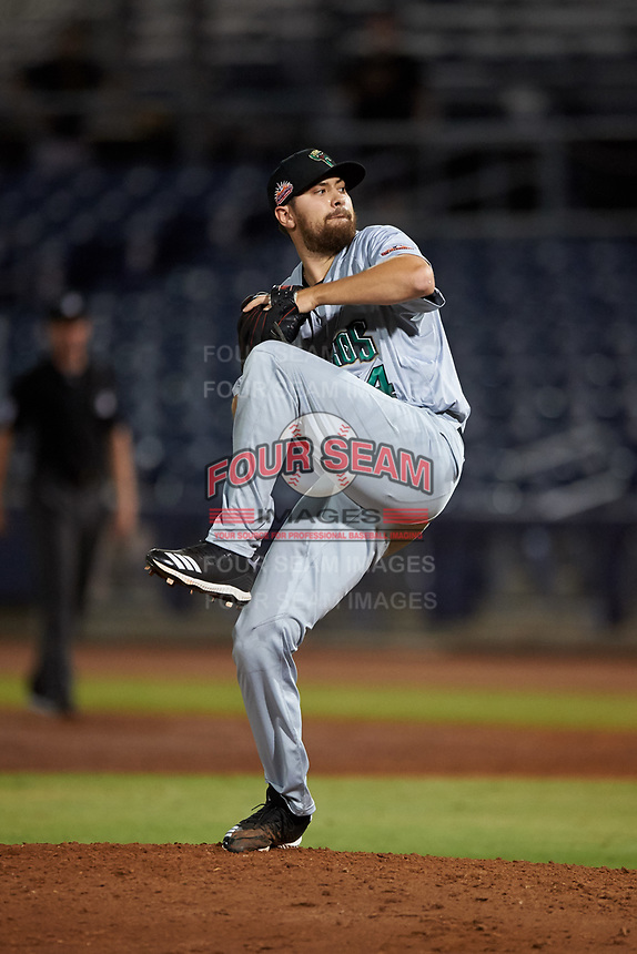 Surprise Saguaros relief pitcher Cole Uvila (34), of the Texas Rangers organization, during an Arizona Fall League game against the Peoria Javelinas on September 22, 2019 at Peoria Sports Complex in Peoria, Arizona. Surprise defeated Peoria 2-1. (Zachary Lucy/Four Seam Images)
