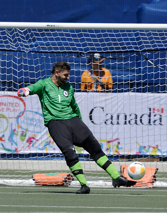 Toronto, ON - Aug 9 2015 -  Damien Wojtiw kicks the ball during Canada vs United States in Football 7-a-side at the Parapan Am Fields during the Toronto 2015 Parapan American Games  (Photo: Matthew Murnaghan/Canadian Paralympic Committee)