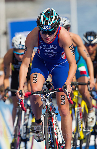 24 AUG 2013 - STOCKHOLM, SWE - Vicky Holland (GBR) of Great Britain climbs a hill on the bike during the elite women's ITU 2013 World Triathlon Series round in Gamla Stan, Stockholm, Sweden (PHOTO COPYRIGHT © 2013 NIGEL FARROW, ALL RIGHTS RESERVED)