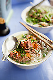 VIETNAM, Hanoi, bowls of pho bo or beef noodle bowls on a table at restaurant Pho Gia Truyen, also known as 49 Bat Dan