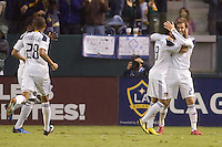 LA Galaxy midfielders David Beckham (r) and teammate Juninho (l) begin to celebrate Juninho's goal. The LA Galaxy defeated FC Dallas 2-1 at Home Depot Center stadium in Carson, California on Sunday October 24, 2010.
