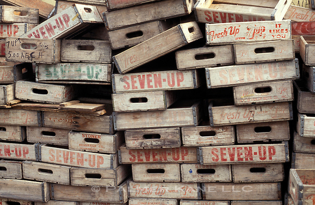 Old wooden 7-up soda crates stacked for recycling