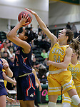SPEARFISH, SD: DECEMBER 30:  Danielle Noble #34 of Black Hills State blocks Khiya Adams #13 of CSU Pueblo during their game Saturday evening at the Donald E. Young Center in Spearfish, S.D.   (Photo by Dick Carlson/Inertia