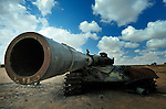 A tank used by troops loyal to Libyan strongman Moammar Gadhafi which was destroyed during a NATO air strike near Misrata.