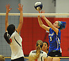 Mattituck No. 5 Kathryn Zaloom, right, tips a ball over the net during the Suffolk County varsity girls' volleyball Class C final against Babylon at Suffolk Community College Grant Campus on Monday, November 9, 2015. Mattituck won 3-1.