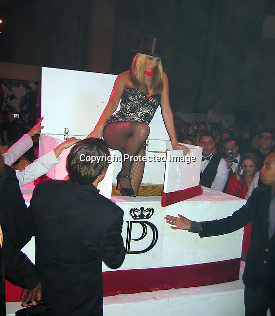 Girls coming out of a cake<br />Sean P. Diddy Combs Celebrates his 35th birthday by giving himself a Royal Birthday Ball<br />Cipriani Wall Street<br />New York, NY, USA<br />Thursday, November 04, 2004<br />Photo By Celebrityvibe.com/Photovibe.com, New York, USA, Phone 212 410 5354, email:sales@celebrityvibe.com