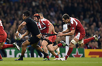 Shalva Sutiashvili of Georgia attempts a last-ditch tackle on Julian Savea of New Zealand. Rugby World Cup Pool C match between New Zealand and Georgia on October 2, 2015 at the Millennium Stadium in Cardiff, Wales. Photo by: Patrick Khachfe / Onside Images