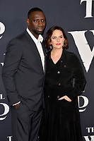 "LOS ANGELES, CA: 13, 2020: Omar Sy & Helene Sy at the world premiere of ""The Call of the Wild"" at the El Capitan Theatre.<br /> Picture: Paul Smith/Featureflash"