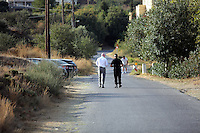 Pictured: Detective Inspector Jon Cousins of South Yorkshire Police (L) and a colleague leave the new site in Kos, Greece. Saturday 08 October 2016<br />