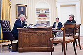 National Security Advisor Michael Flynn and Senior Counselor to the President Steve Bannon, sit nearby as United States President Donald Trump speaks on the phone with Prime Minister of Australia, Malcolm Turnbull in the Oval Office on January 28, 2017 in Washington, DC, The call was one of five calls with foreign leaders scheduled for Saturday.   <br /> Credit: Pete Marovich / Pool via CNP